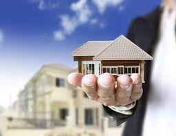 man holding on miniature house - By What You Can Choose the Best Real Estate Solutions